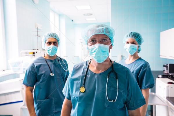 Portrait of surgeon and nurses standing in hospital Stock photo © wavebreak_media