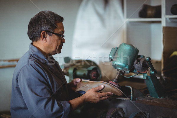 Shoemaker polishing a shoe with machine Stock photo © wavebreak_media