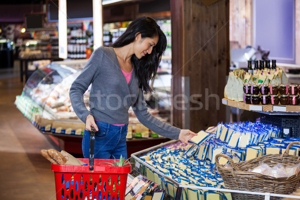 Woman selecting dairy products in grocery section Stock photo © wavebreak_media