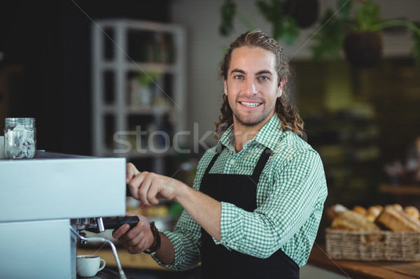 Portrait of smiling waiter making cup of coffee Stock photo © wavebreak_media