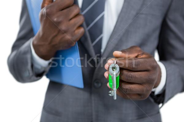 Középső rész üzletember tart kulcsok fehér kulcs Stock fotó © wavebreak_media