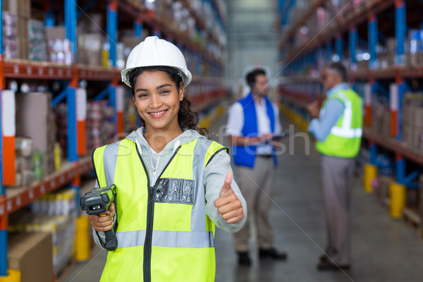 Female warehouse worker showing thumbs up sign Stock photo © wavebreak_media