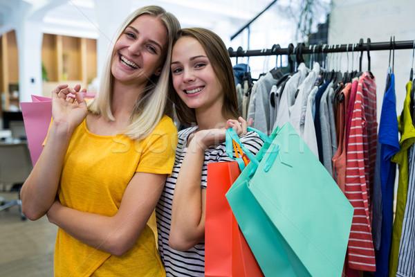 Nők vásárlás ruházat bolt portré divat Stock fotó © wavebreak_media