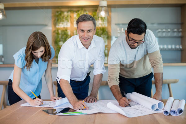 Architects working over blueprint in conference room Stock photo © wavebreak_media