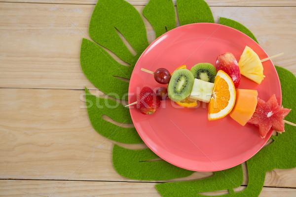 Overhead of fruit skewers in plate Stock photo © wavebreak_media