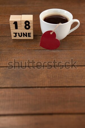 Red cup and saucer on table in coffee shop Stock photo © wavebreak_media