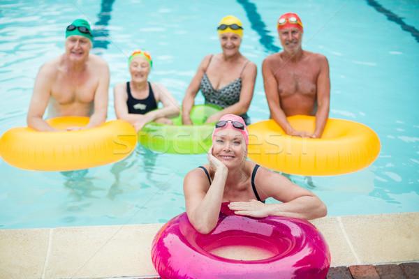 Felfújható gyűrűk medence nő víz boldog Stock fotó © wavebreak_media