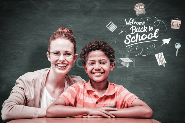 Composite image of happy pupil and teacher Stock photo © wavebreak_media