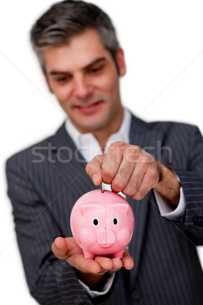 Sophisticated male executive saving money in a piggybank Stock photo © wavebreak_media