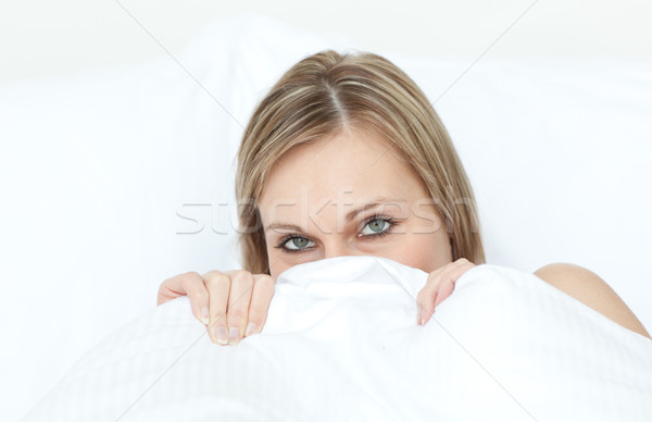 Close-up of a woman hiding in her bed  Stock photo © wavebreak_media