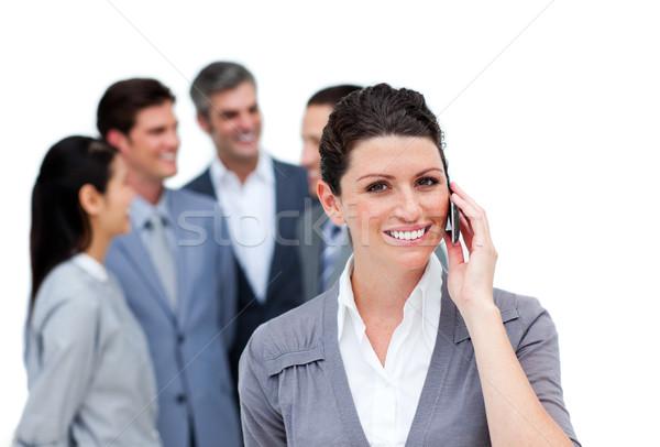 Barna hajú nő beszél telefon csapat fehér Stock fotó © wavebreak_media