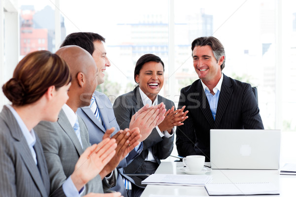 Smiling multi-ethnic business team applauding Stock photo © wavebreak_media
