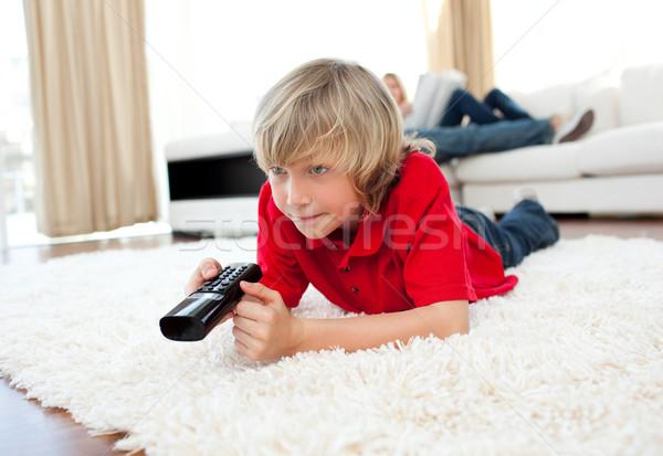 Aranyos fiú tart távoli padló nappali Stock fotó © wavebreak_media