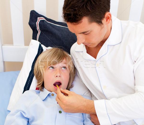 Affectionate father checking his son's temperature Stock photo © wavebreak_media