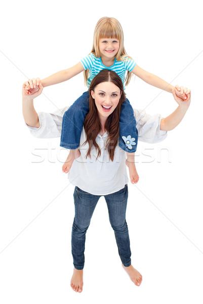 Beautiful mother giving her daughter piggyback ride Stock photo © wavebreak_media