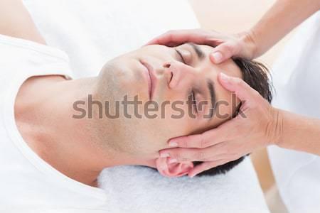 Cute женщину наушники кровать домой музыку Сток-фото © wavebreak_media