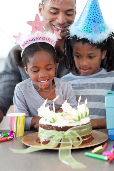 Ethnic little girl and her family celebrating her birthday Stock photo © wavebreak_media