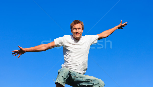 Young man jumping in the air Stock photo © wavebreak_media