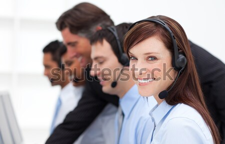 Concentrated female leader with a team on a call center Stock photo © wavebreak_media