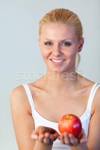 Beautiful woman holding chocolate and apple focus on woman  Stock photo © wavebreak_media