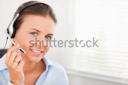 Cute imprenditrice parlando clienti computer ufficio Foto d'archivio © wavebreak_media