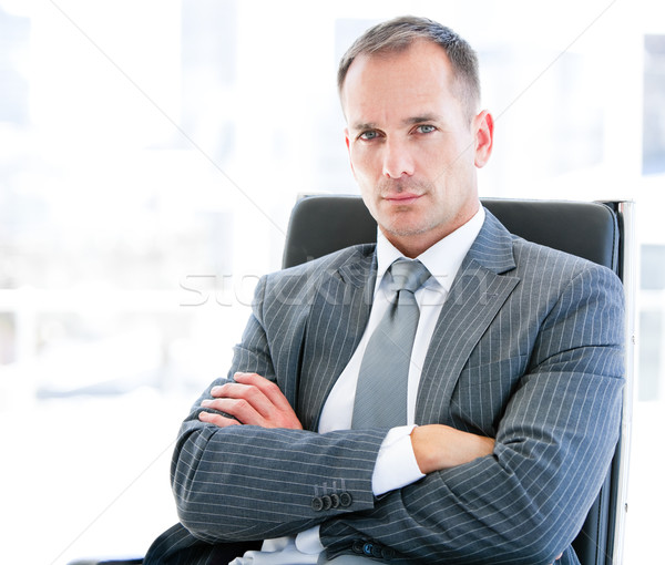 Confident businessman looking at the camera sitting in the office Stock photo © wavebreak_media