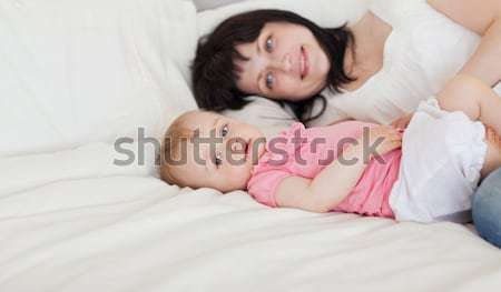 Young family resting together in parent's bed Stock photo © wavebreak_media