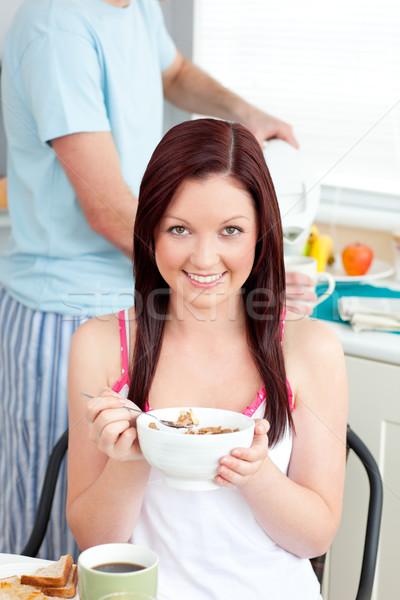 очаровательный женщину еды завтрак домой Сток-фото © wavebreak_media