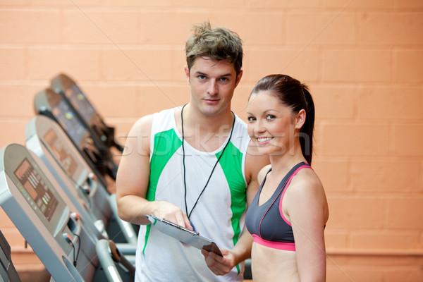 Jolie femme coach résultats fitness Photo stock © wavebreak_media
