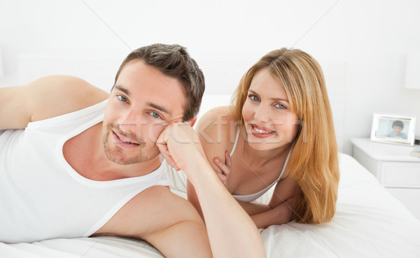 Couple lying down together in their bed at home Stock photo © wavebreak_media