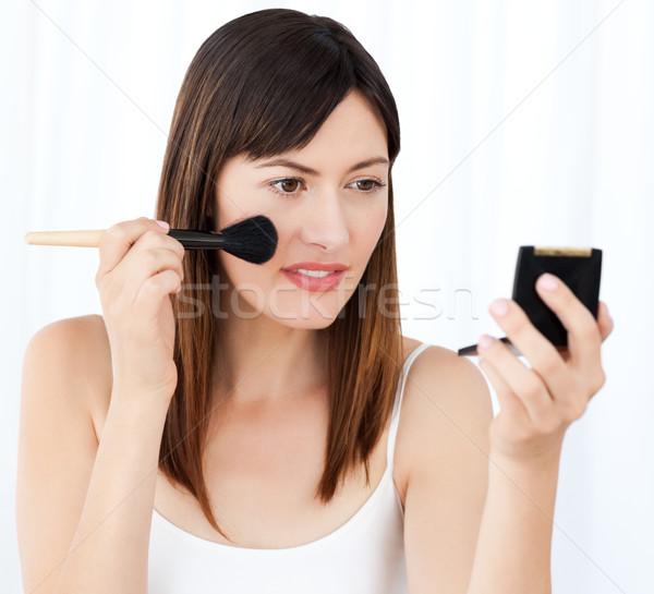 Lovely woman making up  Stock photo © wavebreak_media