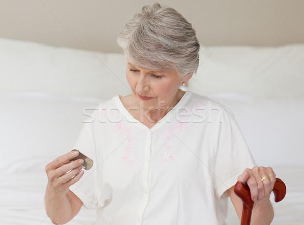 Sick senior woman taking her pills at home Stock photo © wavebreak_media