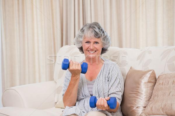 Woman doing her exercises on her sofa Stock photo © wavebreak_media