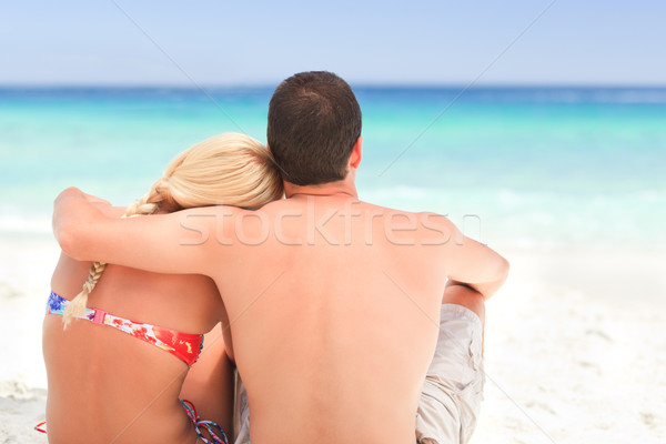 Man hugging his girlfriend while they are looking at the sea Stock photo © wavebreak_media