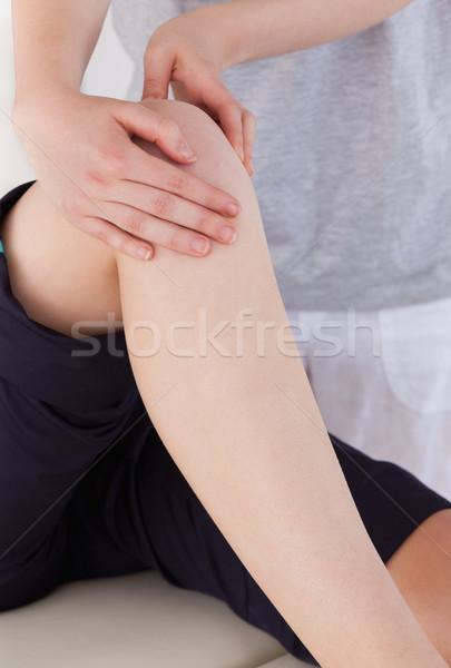 Portret masseuse knie atletisch vrouw Stockfoto © wavebreak_media