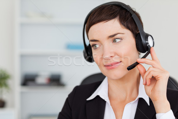 Close up of a secretary calling with a headset in her office Stock photo © wavebreak_media