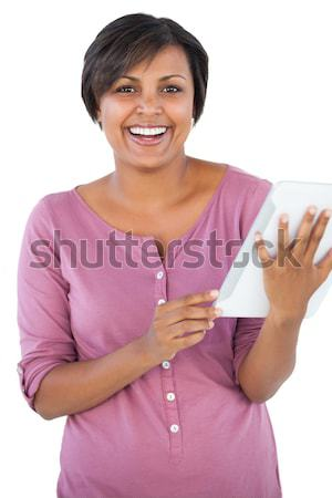 Lovely woman eating a chocolate bar while standing against a white background Stock photo © wavebreak_media
