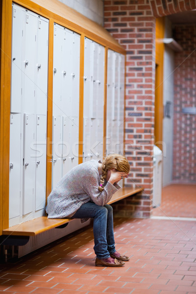 Portrait of a lonely student sitting in a corridor Stock photo © wavebreak_media