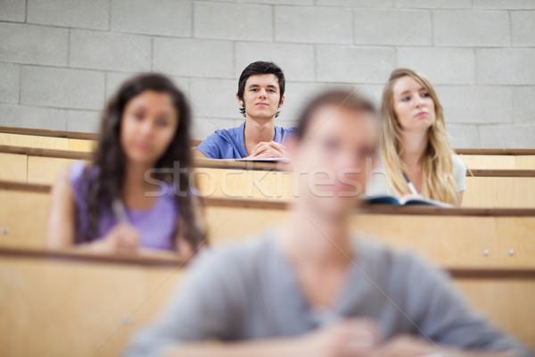 Uśmiechnięty studentów słuchania wykład kamery skupić Zdjęcia stock © wavebreak_media