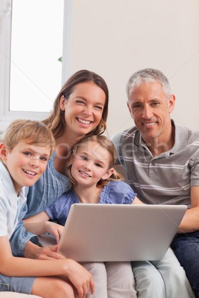 портрет семьи сидят диване используя ноутбук гостиной Сток-фото © wavebreak_media