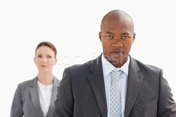 üzletember bámul kamera üzletasszony mögött arc Stock fotó © wavebreak_media