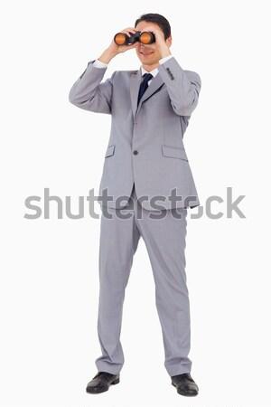 Zakenman glimlachend verrekijker witte werk achtergrond Stockfoto © wavebreak_media