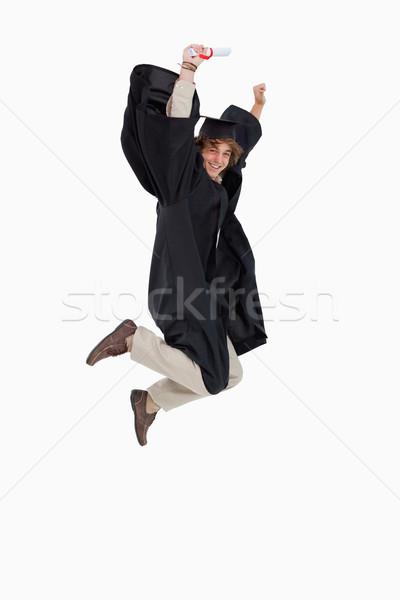 Feliz masculina estudiante posgrado túnica saltar Foto stock © wavebreak_media