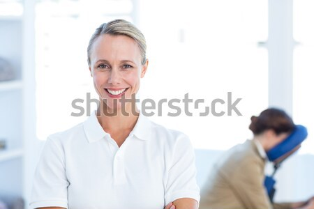 Doctor showing a beaming smile with his medical interns behind him Stock photo © wavebreak_media