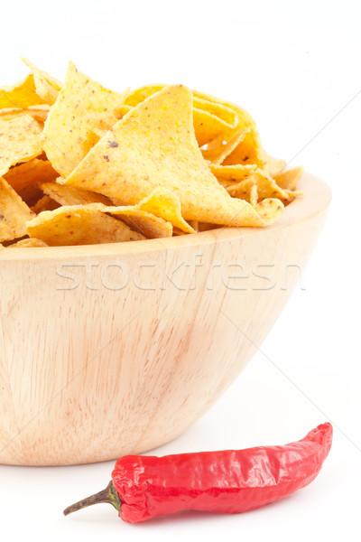 Pimento next to a bowl of crisps against white background  Stock photo © wavebreak_media