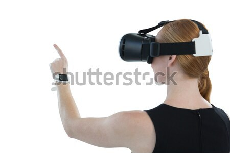 Woman aiming with a SLR camera while smiling against white background Stock photo © wavebreak_media