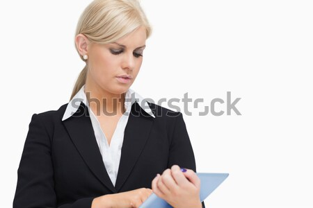 Serious blond businesswoman against white background Stock photo © wavebreak_media