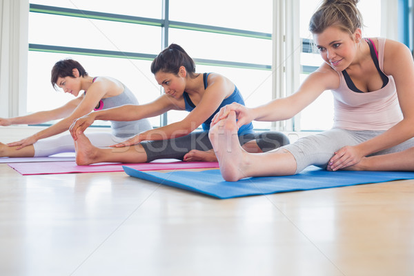 Women stretching in yoga class in fitness studio Stock photo © wavebreak_media