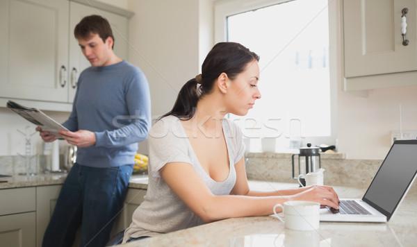 два человека кухне используя ноутбук чтение журнала компьютер Сток-фото © wavebreak_media