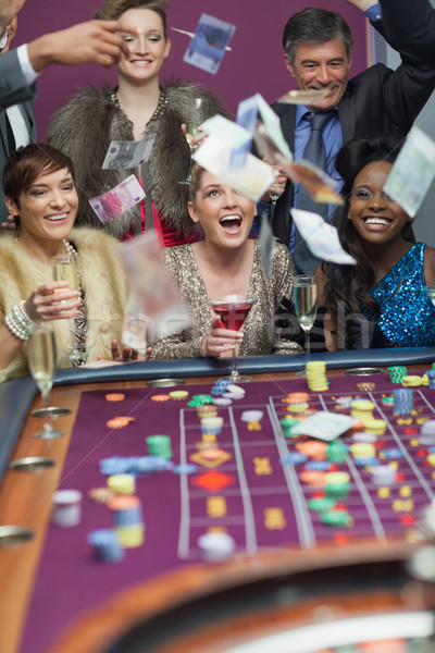 People throwing money while smiling at the casino Stock photo © wavebreak_media